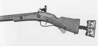 Thumbnail image of Flintlock gun. Scottish, the barrel is dated 1624, the lock about 1690. The royal crown may indicate that it was made for James I