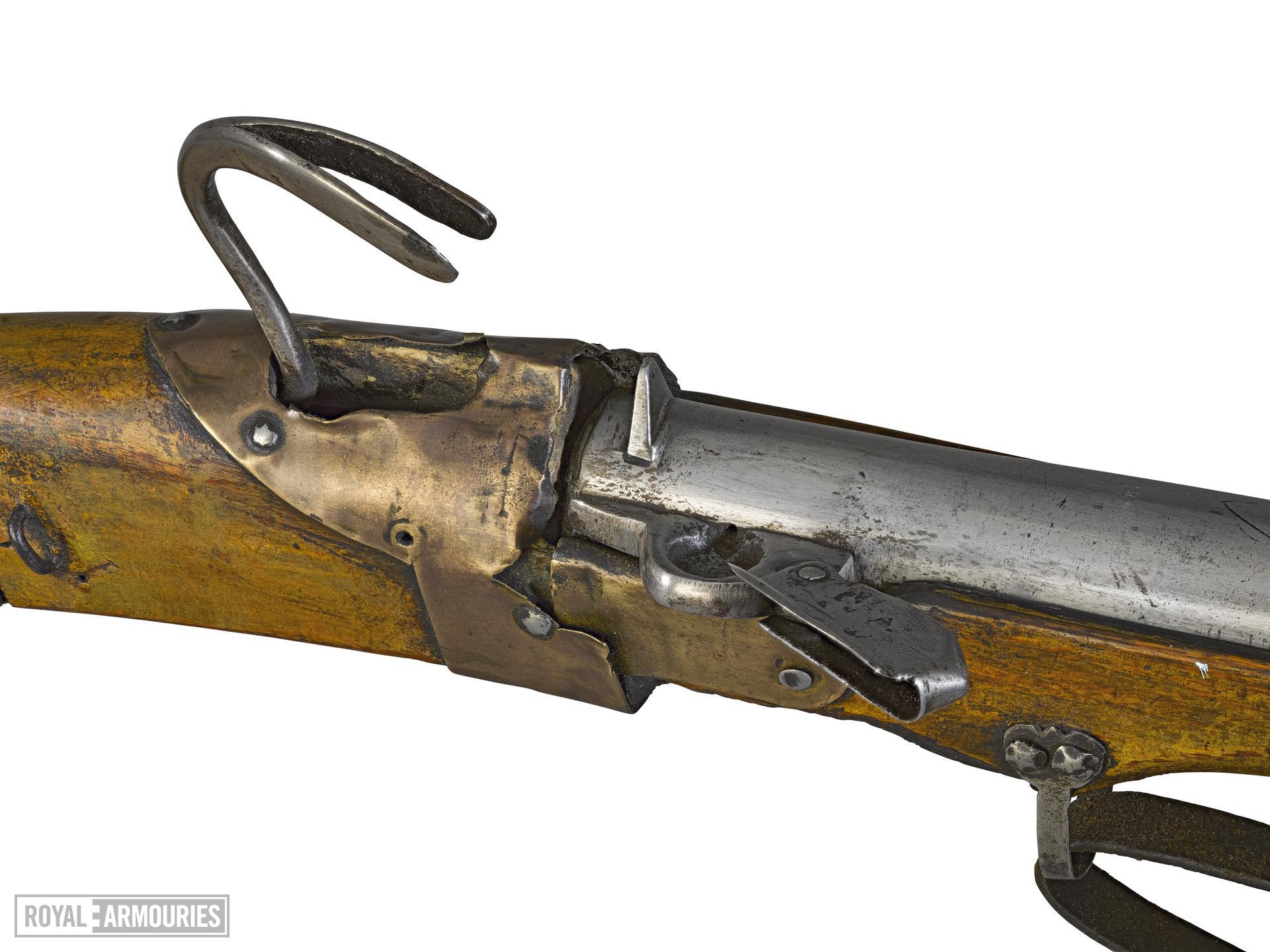 Musket with joined barrel.