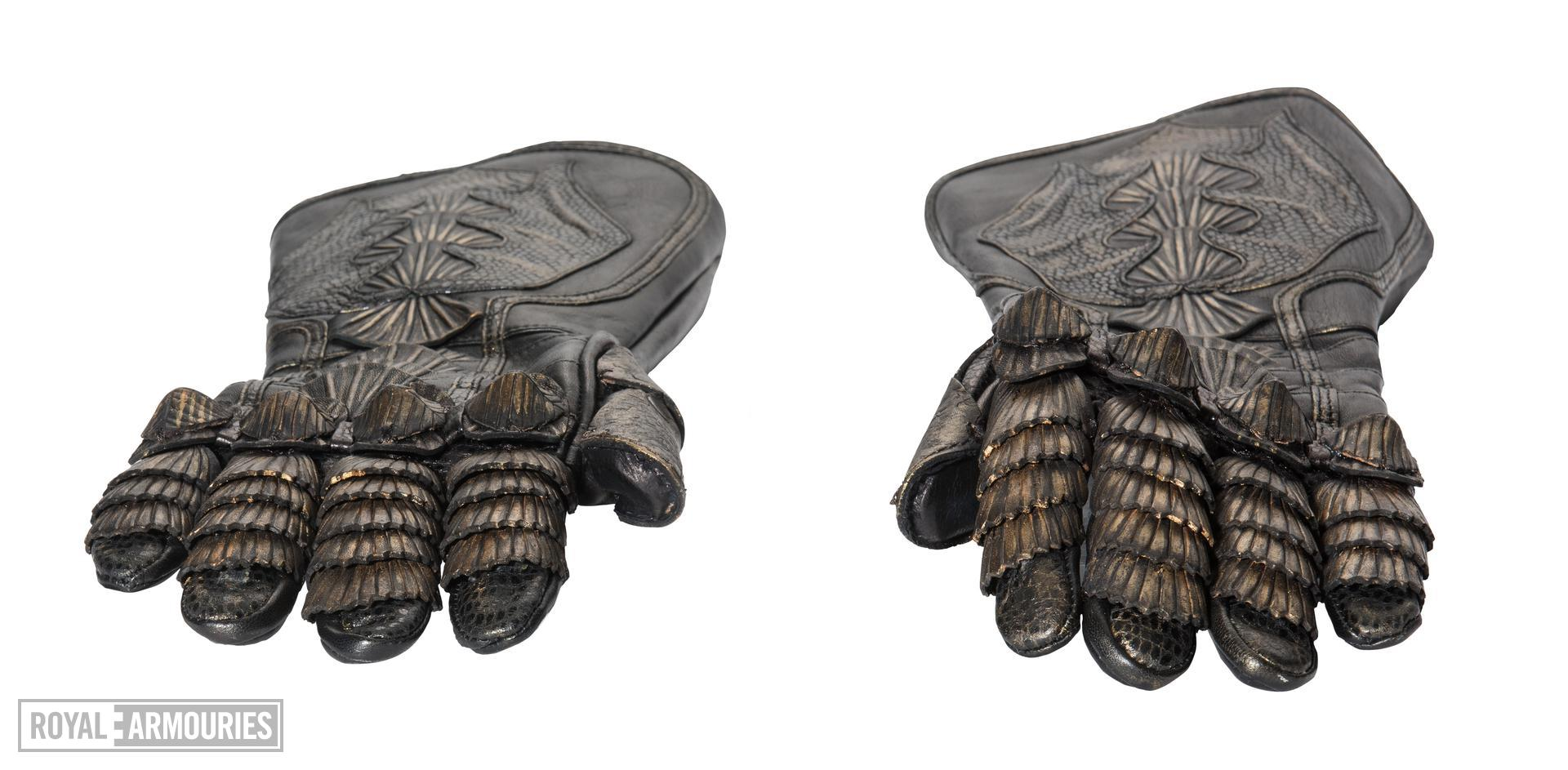 Gloves from The Lord Marshal's Costume. Part of the Lord Marshal's costume from the film the Chronicles of Riddick. Ornately decorated and highly detailed. Bronze and black in appearance but made from leather.