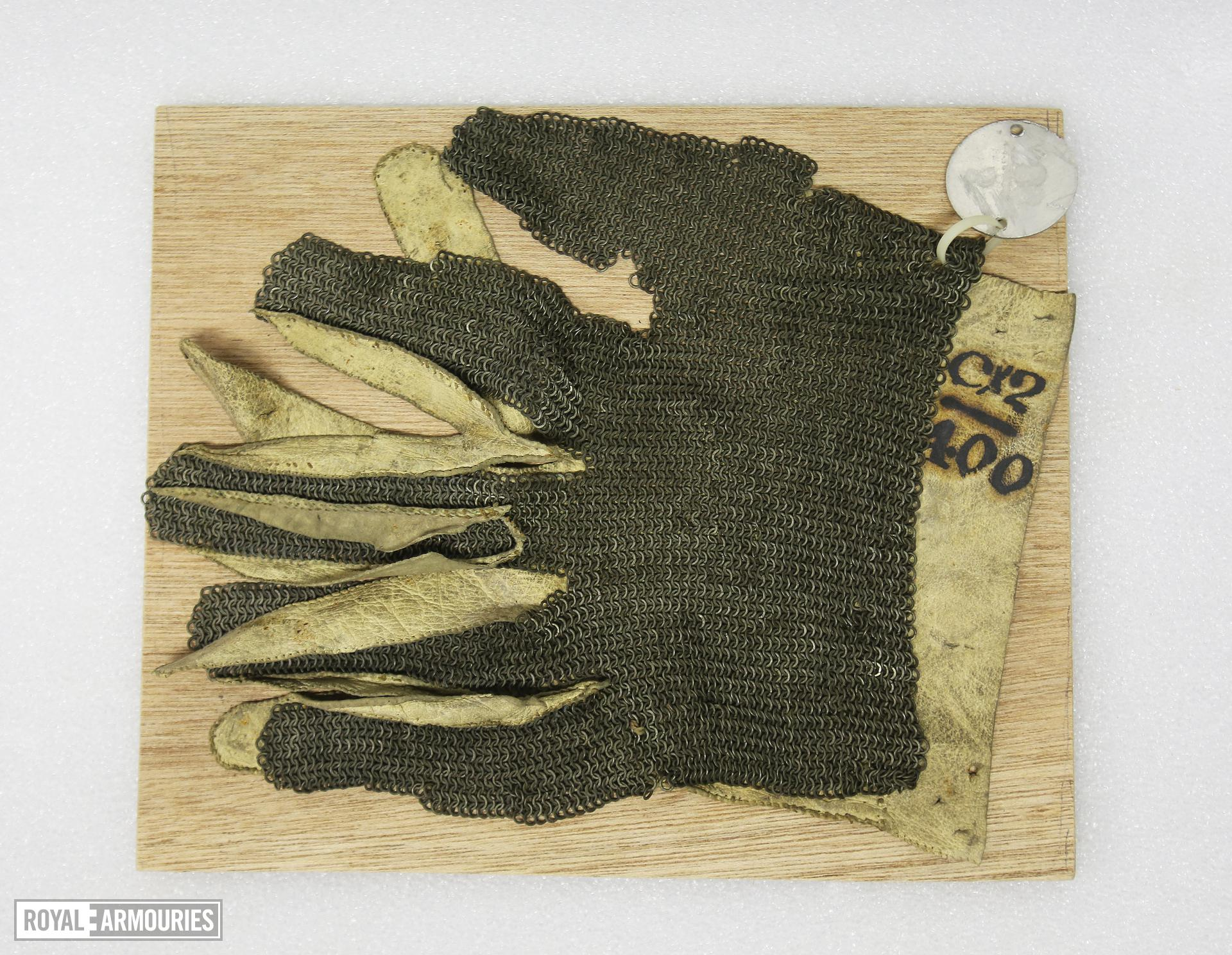 Mail gauntlet fragment. Fine mail covering for a duelling glove. III.788