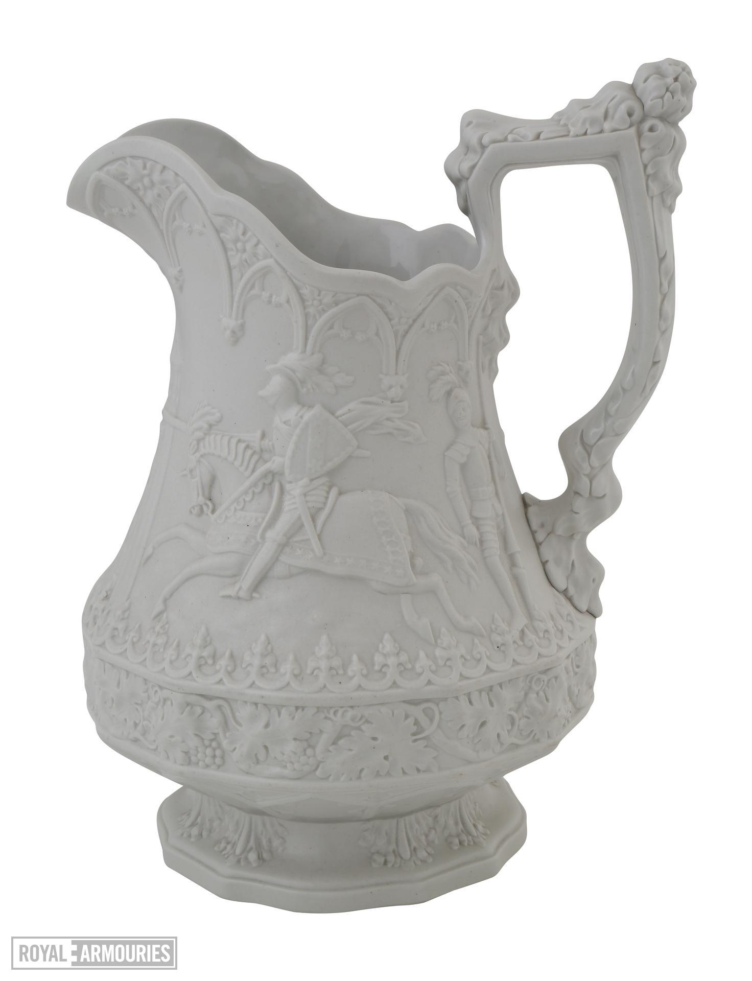Relief moulded, white stoneware jug showing scenes of jousting knights, a souvenir of the Eglinton Tournament of 1839. Marked as made by 'William Ridgway Son and Company'. Hanley, Staffordshire, 1840 XVIII.899