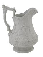 Thumbnail image of Relief moulded, white stoneware jug showing scenes of jousting knights, a souvenir of the Eglinton Tournament of 1839. Marked as made by 'William Ridgway Son and Company'. Hanley, Staffordshire, 1840 XVIII.899