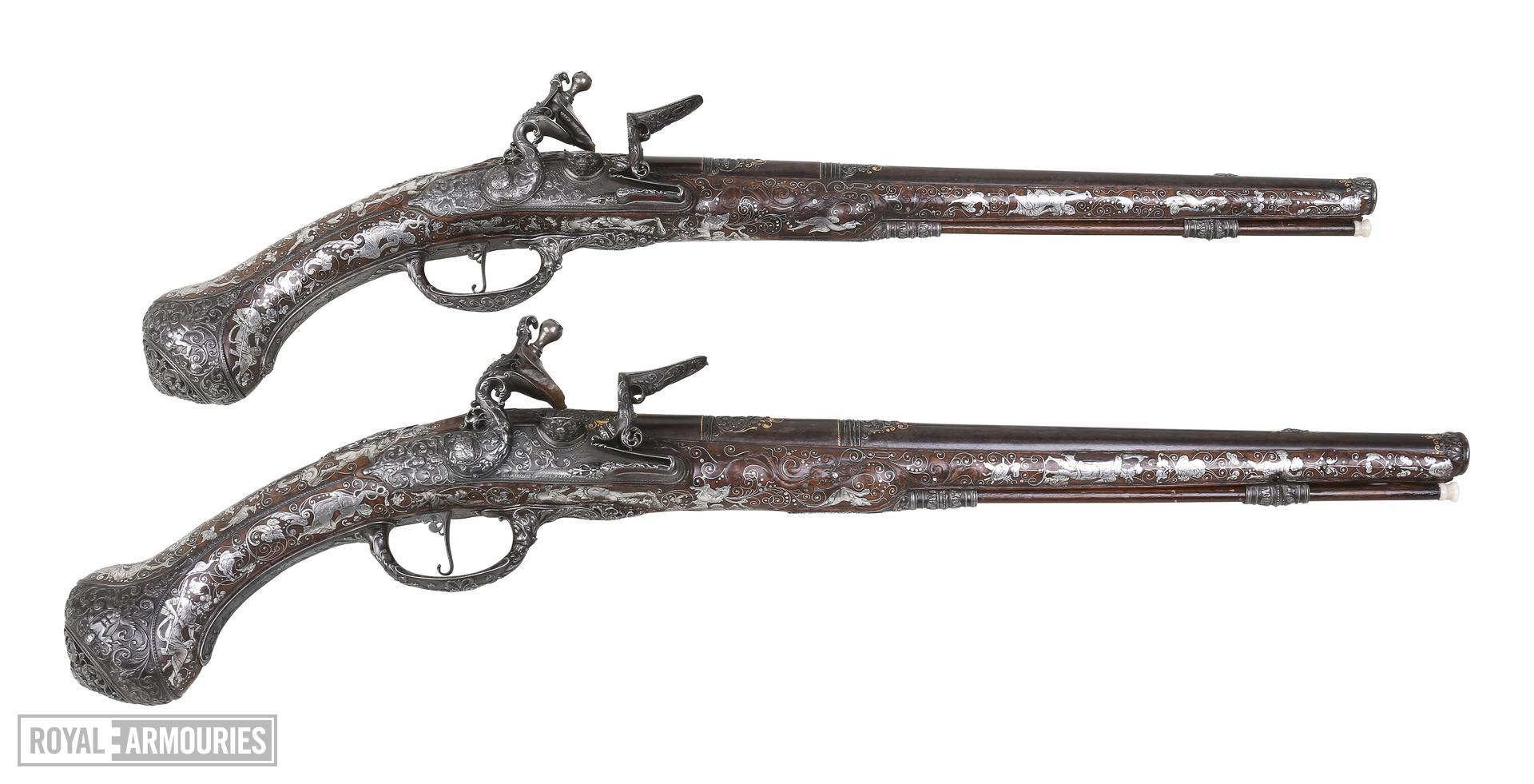 Pair of flintlock holster pistols By Peter Monlong, XII.3830 & XII.3829