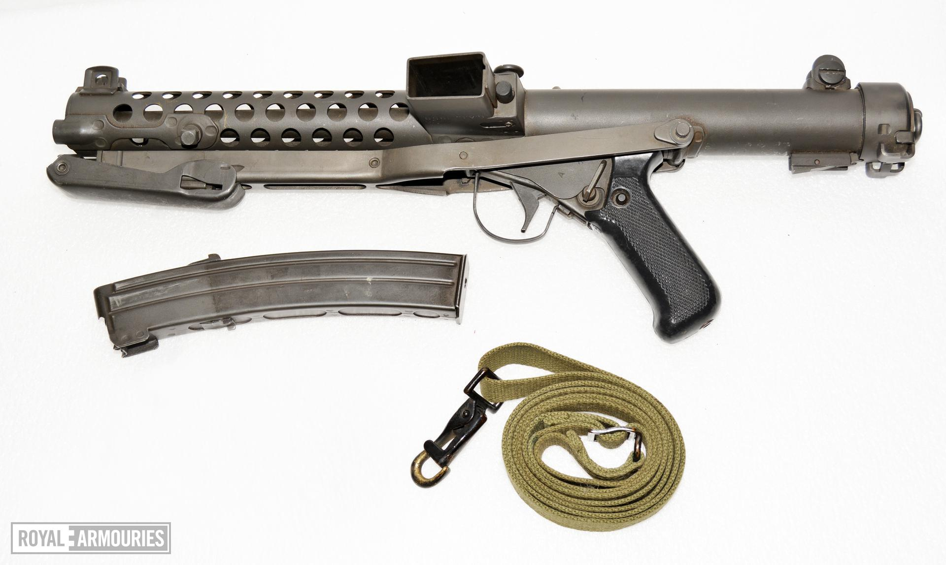 Canadian SMG 9 mm C1 with stock in folded position. Shown with issue magazine and sling. PR.7598