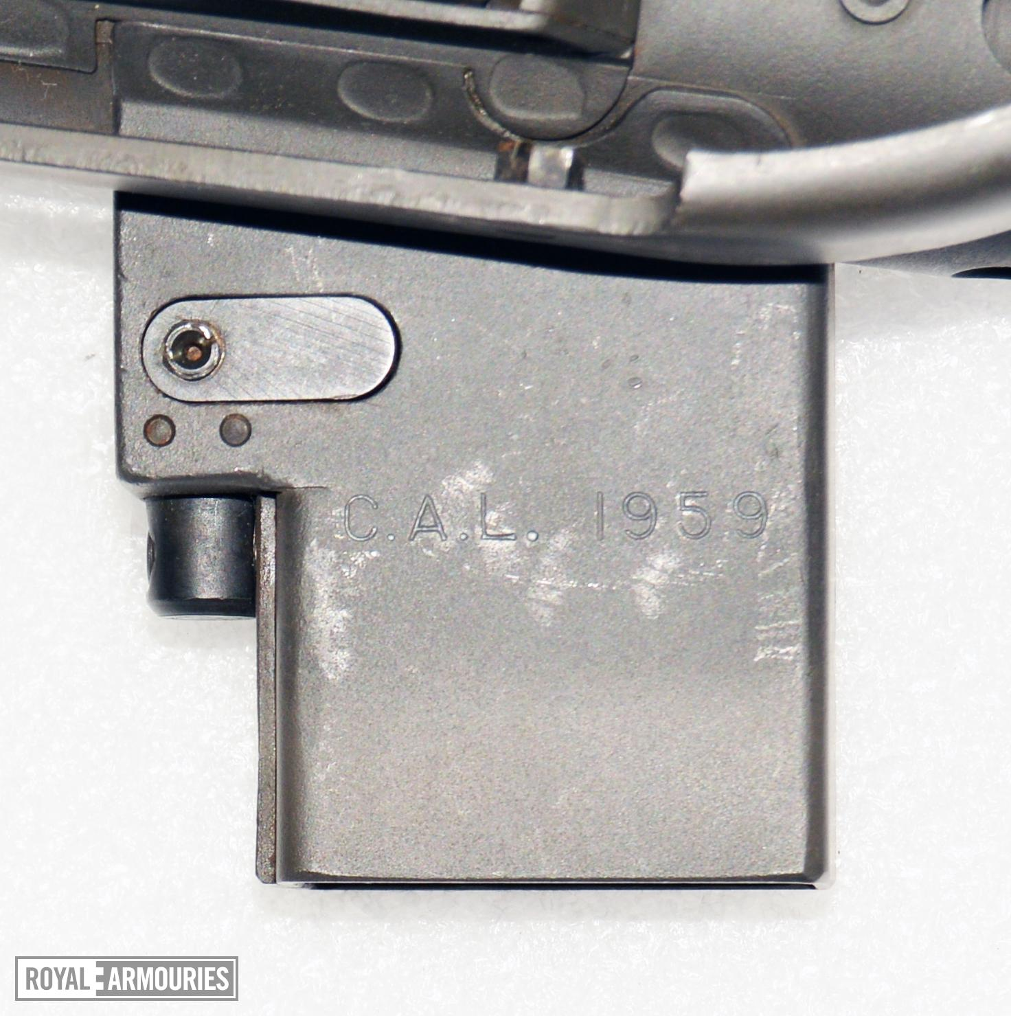 Underside of  SMG 9 mm C1 magzine housing showing manufacturings initials PR.7598