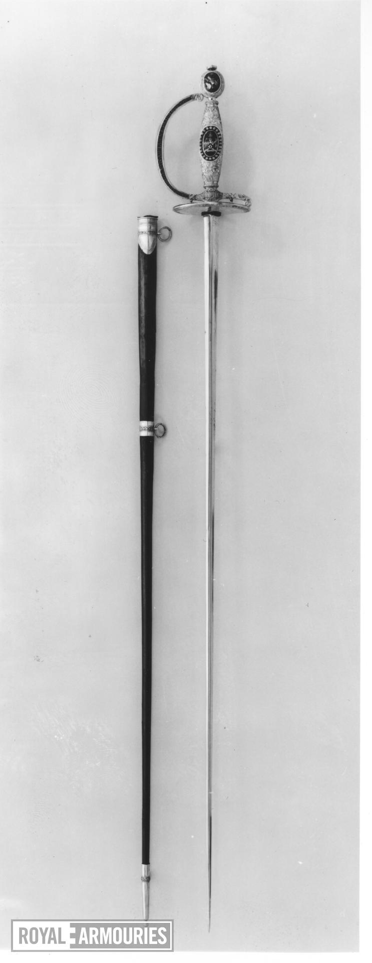 Sword and scabbard Small sword and scabbard. Presentation sword to Lord Collingwood from Corporation of the City of London, inscription giving the date 26.11.1805, hallmark with date letter for 1806/7; hilt and scabbard fittings by John Ray and James Montague; retailed by Thomas Harper.