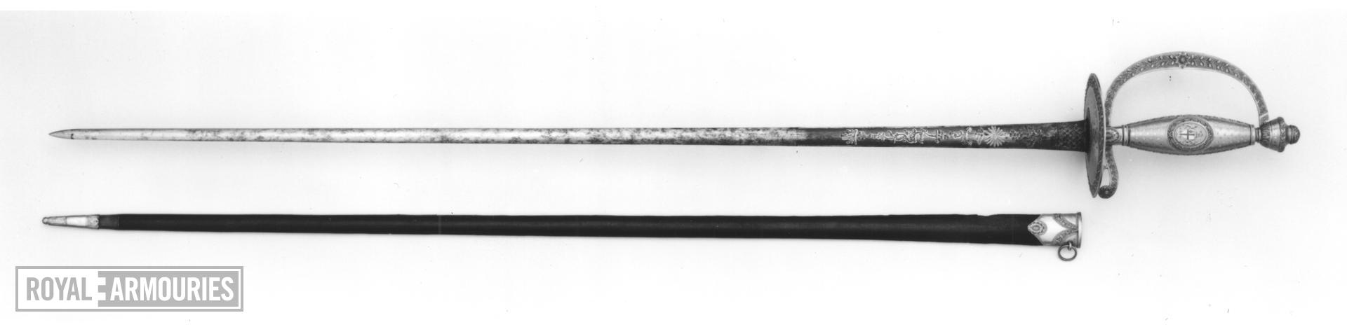 Sword and scabbard Presentation small-sword and scabbard. Presented to Lieut. Popham, RN, by the H E I C, 1786.