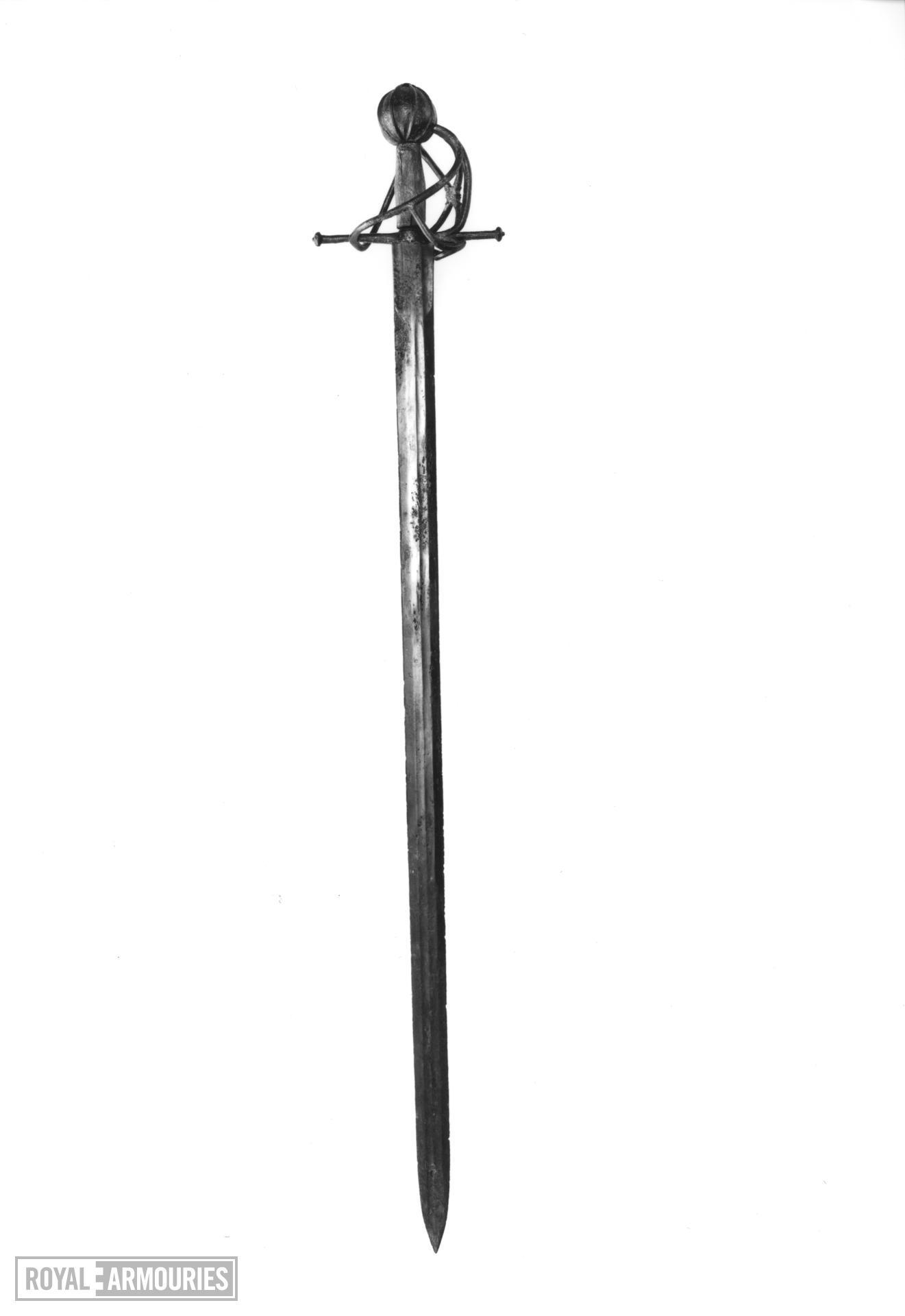 Sword - Basket hilted sword Flattened oval-sectioned wooden grip.
