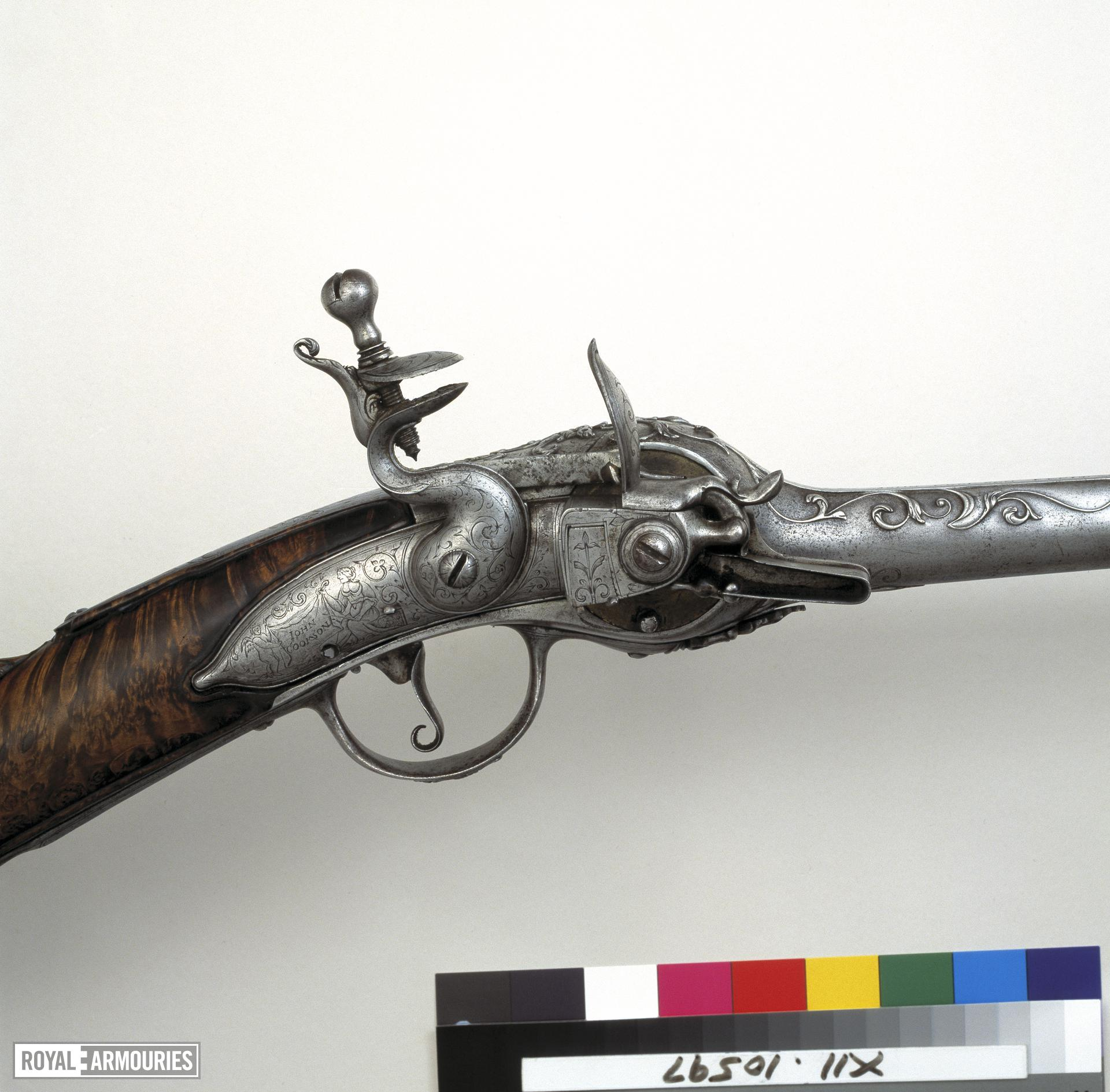 Flintlock breech-loading magazine gun - By John Cookson The action is of Lorenzoni type.