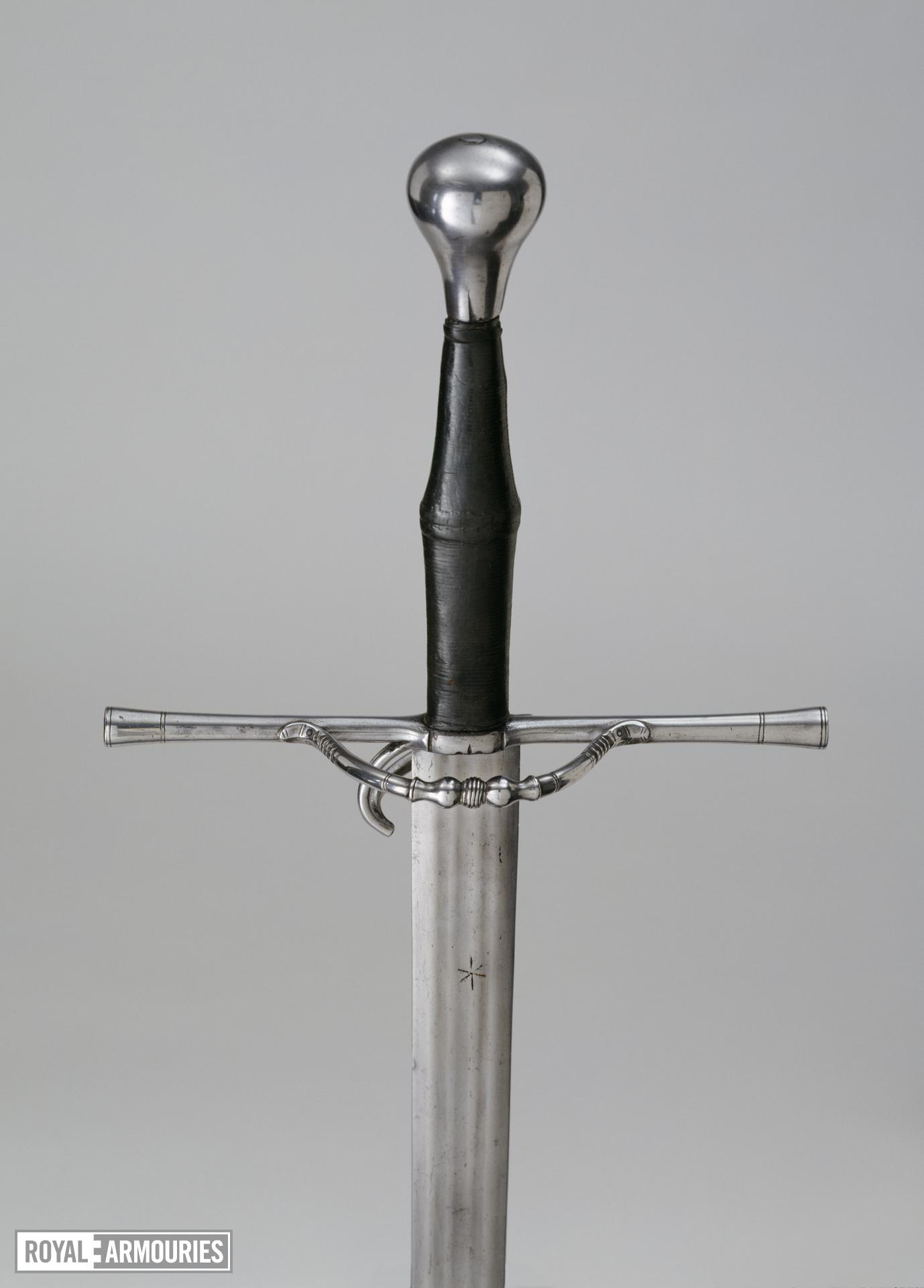 Sword - hand-and-a-half sword with semi-ring-guard.