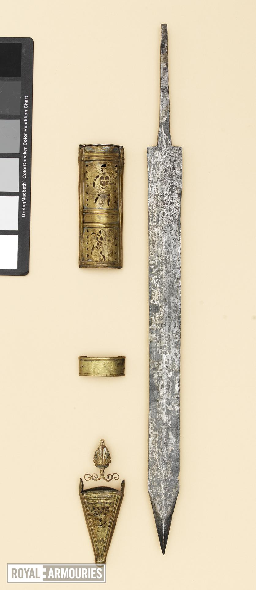 Gladius and scabbard mounts Gladius and scabbard mounts of the 'Pompeii type', from the Alex Guttmann Collection.