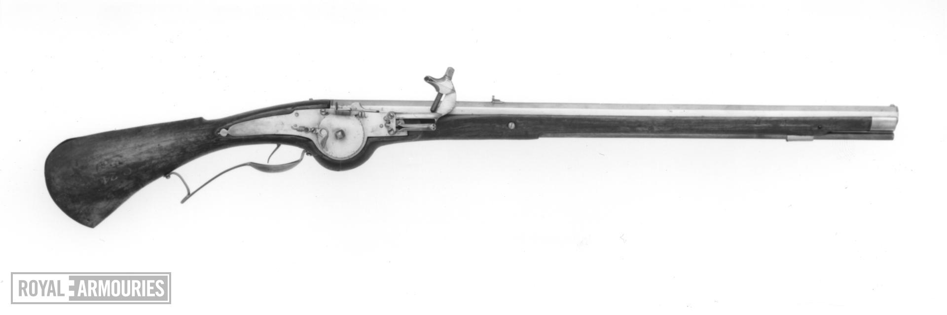 Wheellock muzzle-loading carbine For cavalry. The bearing-plate for the wheel is cut and pierced in a decorative manner