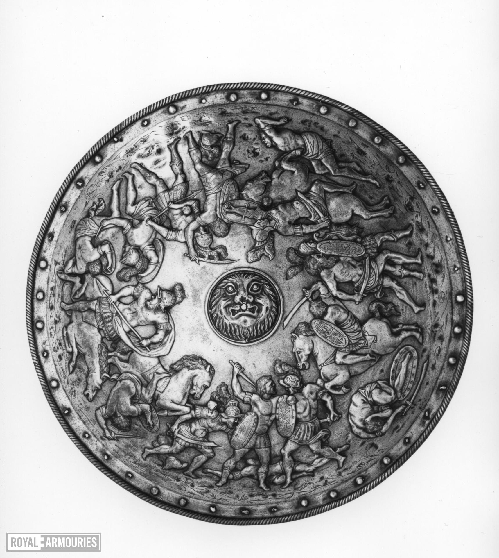 Rondache Embossed with lion and battle scene.