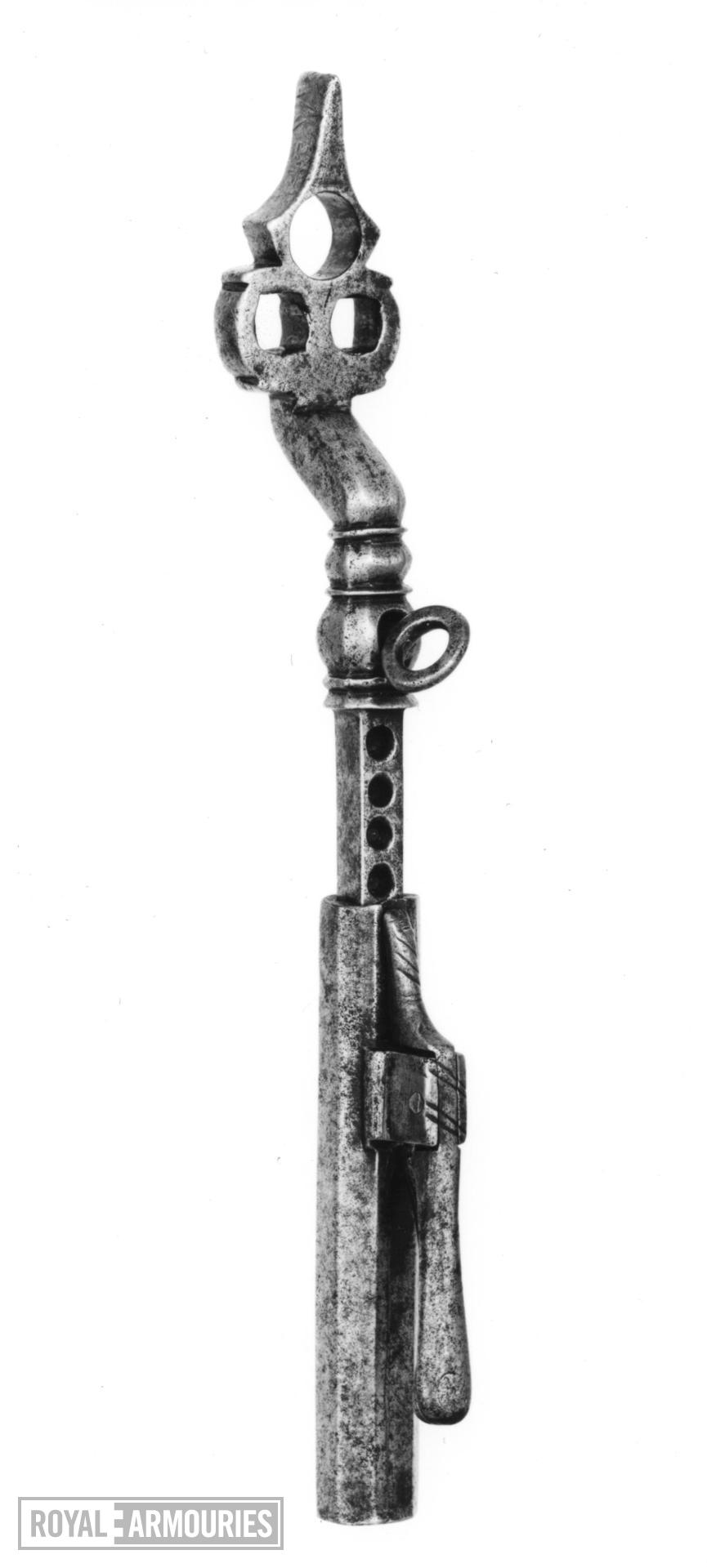 Wheellock spanner The head pierced with two key squares and ending in a turn-screw
