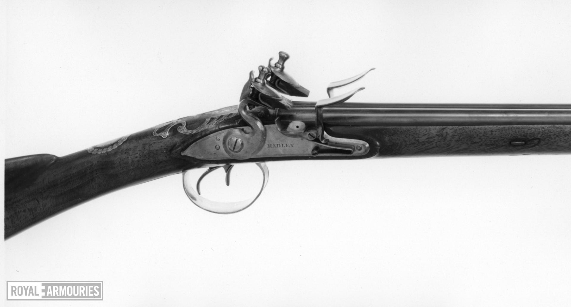 Flintlock double-barrelled shotgun - By Hadley Double side-by-side barrels with hook breeches, the blued finish partly restored.