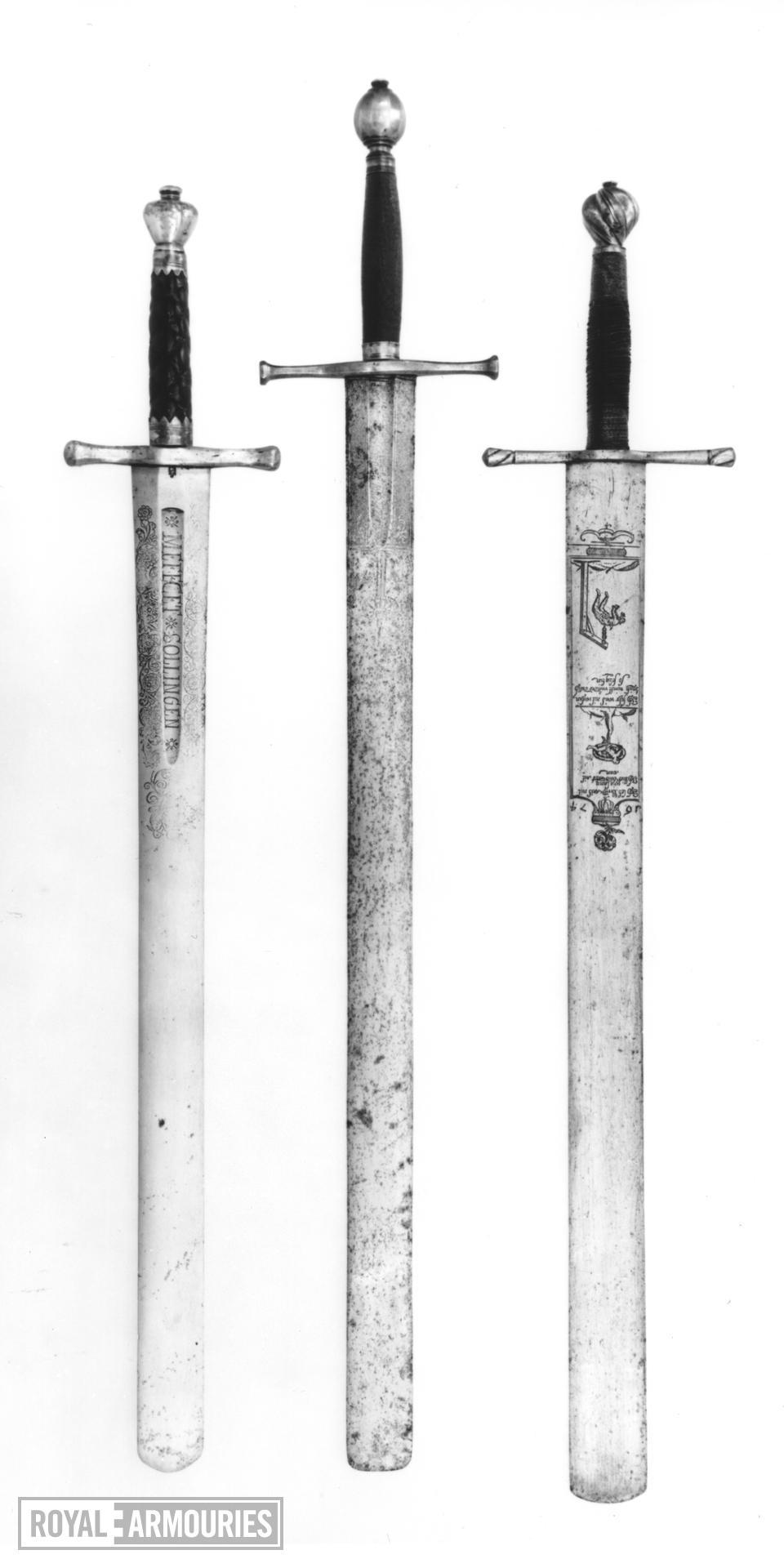 Sword - Executioner's sword with broad balde terminating in blunt tip.