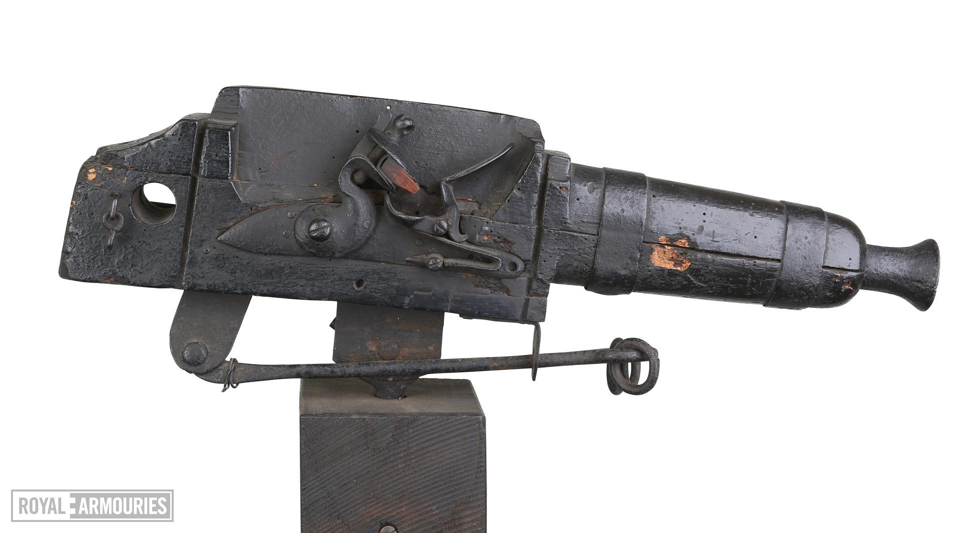 Flintlock alarm gun on wooden stand Bowstead on lock. XII.6003
