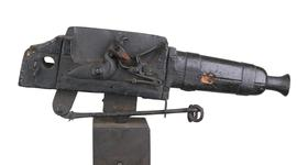Thumbnail image of Flintlock alarm gun on wooden stand Bowstead on lock. XII.6003