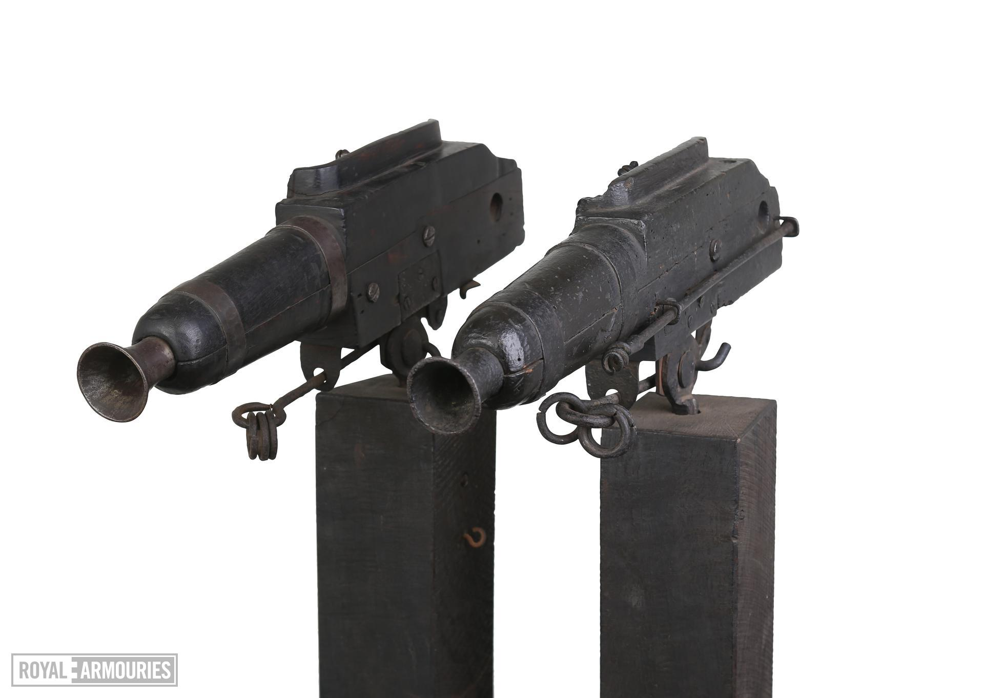 Flintlock alarm guns on wooden stands Bowstead on lock. XII.6003 & XII.6002