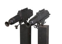 Thumbnail image of Flintlock alarm guns on wooden stands Bowstead on lock. XII.6003 & XII.6002