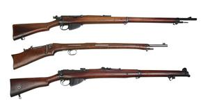 Thumbnail image of Comparison shot of 3 centrefire rifles. Thorneycroft First Pattern PR.5827. Lee Enfield Mk.I, sealed pattern PR.5711.  SMLE Mk.I 2nd Pattern PR.5776