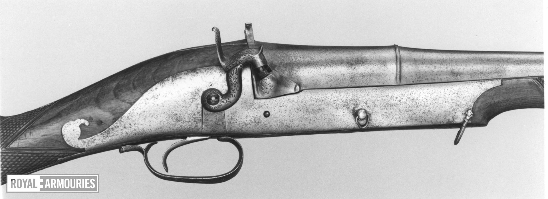 Percussion sporting gun with traditional barrel.