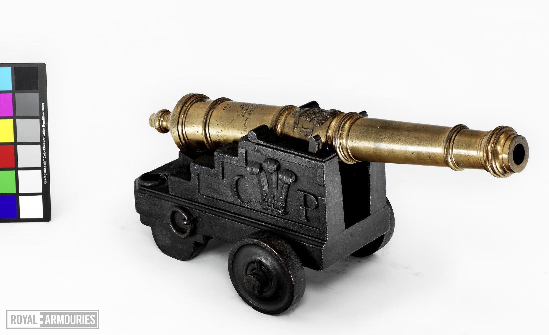 Gun and carriage Made of bronze, small in size Cast by John Browne Carriage of later design One of five guns cf.XIX.24-28.