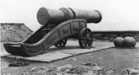 Thumbnail image of Iron bombard known as Mons Meg. Flemish, Mons, mid 15th century (XIX.13) Supplied by Jehan Cambier to Duke Philip the Good of Burgundy. Carriage made in 1934.