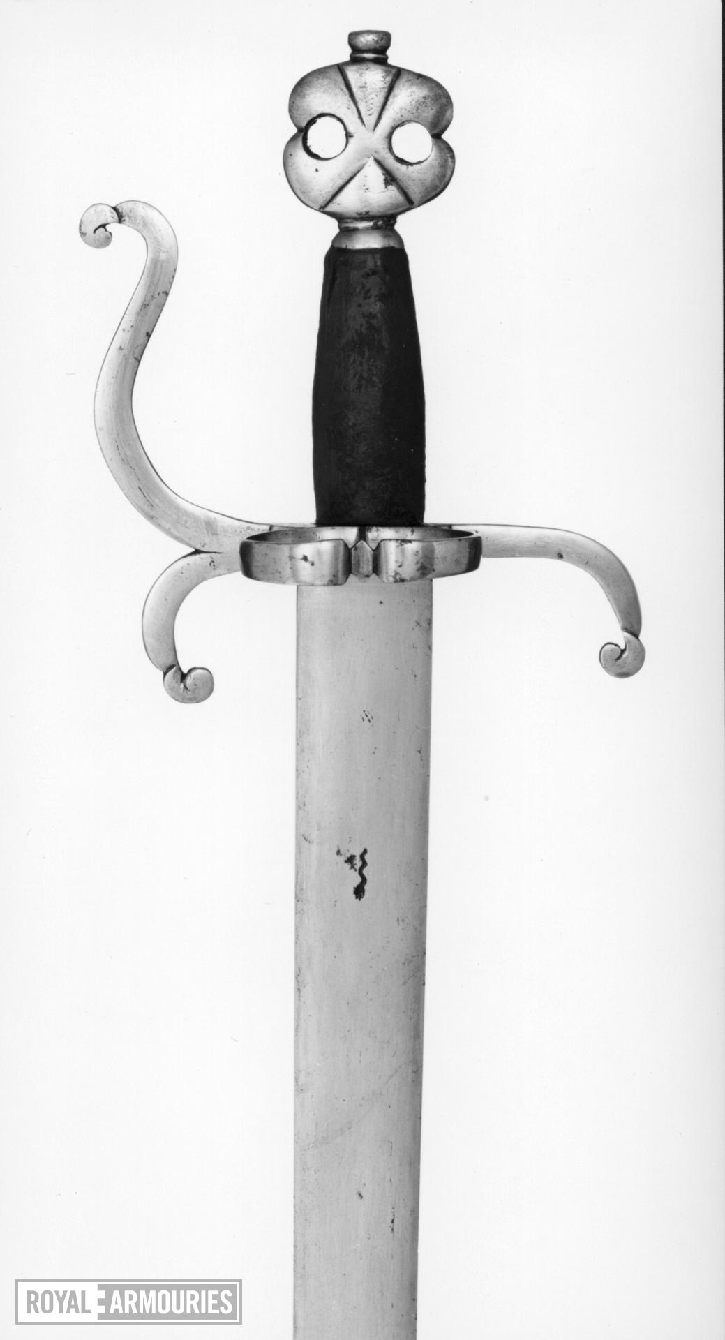 Sword with counter-curved quillons,  and ring-guard