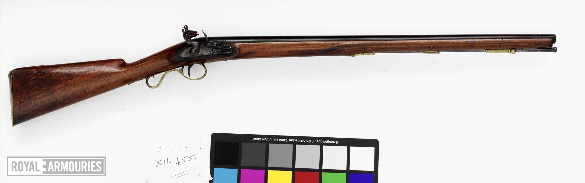 Flintlock gun - By J. Collins