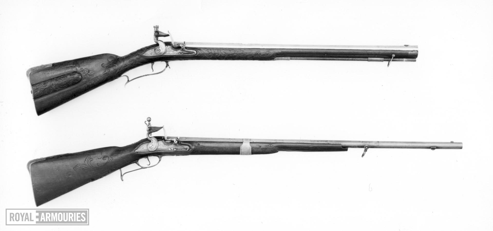 Flintlock muzzle-loading rifle - Unknown Lock with flat lockplate engraved with trophies and a helmeted figure.