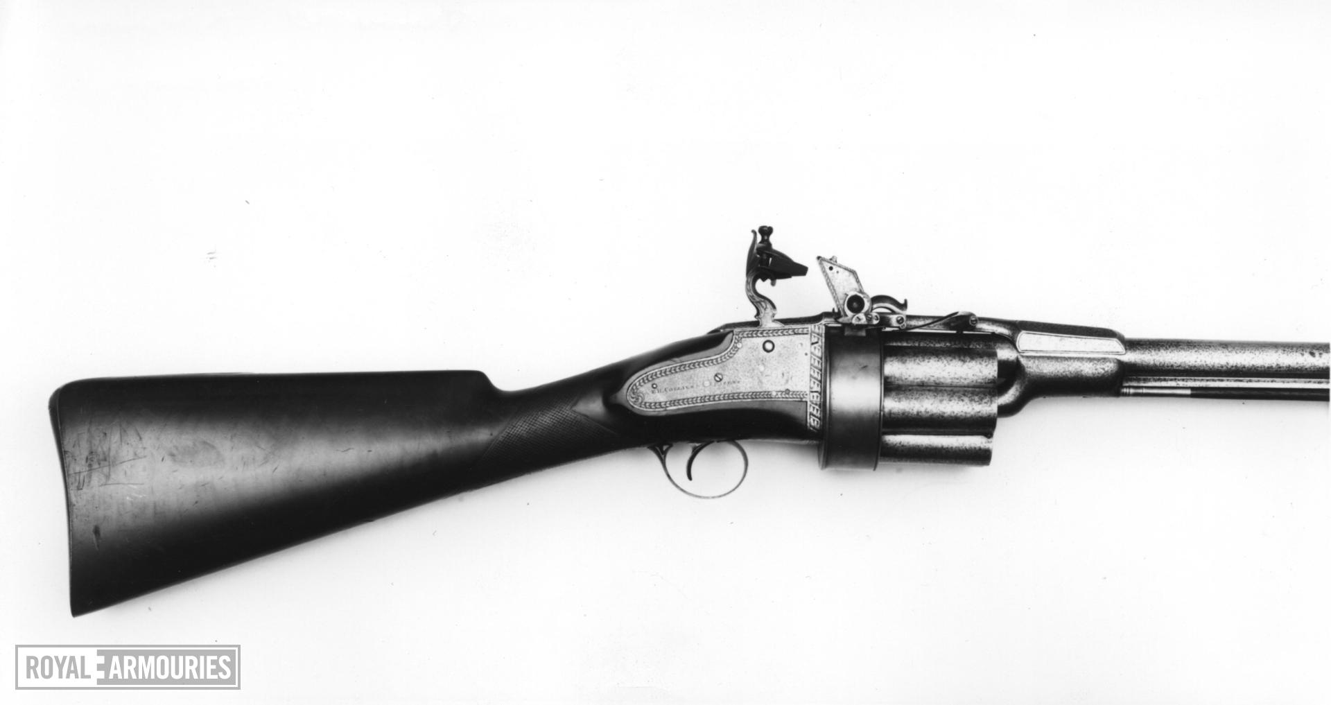 Flintlock revolver gun - By Collier Using Colliers's principle of a revolver with seven shots.