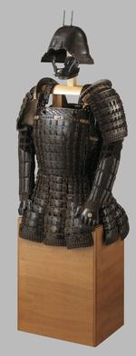 Thumbnail image of Pair of arm defences ( kote ) A pair of armoured sleeves decorated ensuite with the rest of the armour, consisting of solid plates or splints with cross-hatched black lacquer joined together with mail, and kanamono (metal ornaments) with the mon (heraldic crest) made up of two crossed brush strokes.