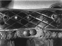 Thumbnail image of Body defence ( Do ) - mogami haramaki A black lacquered, green-laced cuirass with attached gessan (thigh defences). The body armour takes the structure of a haramaki, or 'belly wrapper' armour, wrapping around the body with the opening down the back, with a separate panel of plates (sei ita) to cover the gap. The hinged construction of the solid plates is called 'mogami', after an area of Japan particularly associated with production of this form of armour.