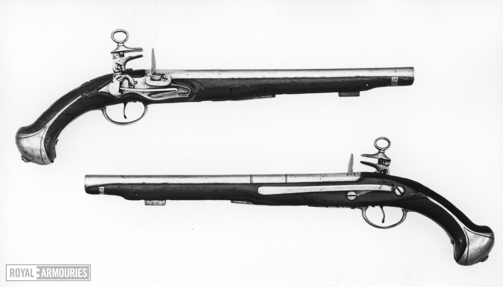 Flintlock pistol One of a pair see XII.879.  Lock of Migulet type