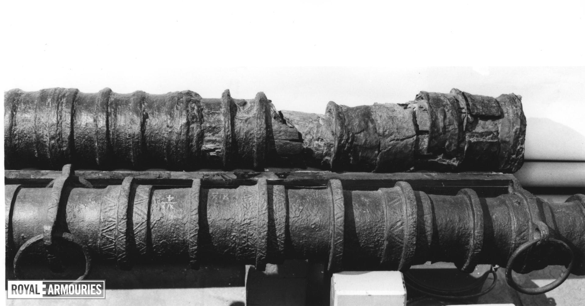 Breech-Loading Iron Gun and Bed Section of a wrought-iron ' hoop & band' gun. Section of wooden bed.