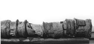 Thumbnail image of Breech-Loading Iron Gun and Bed Section of a wrought-iron ' hoop & band' gun. Section of wooden bed.