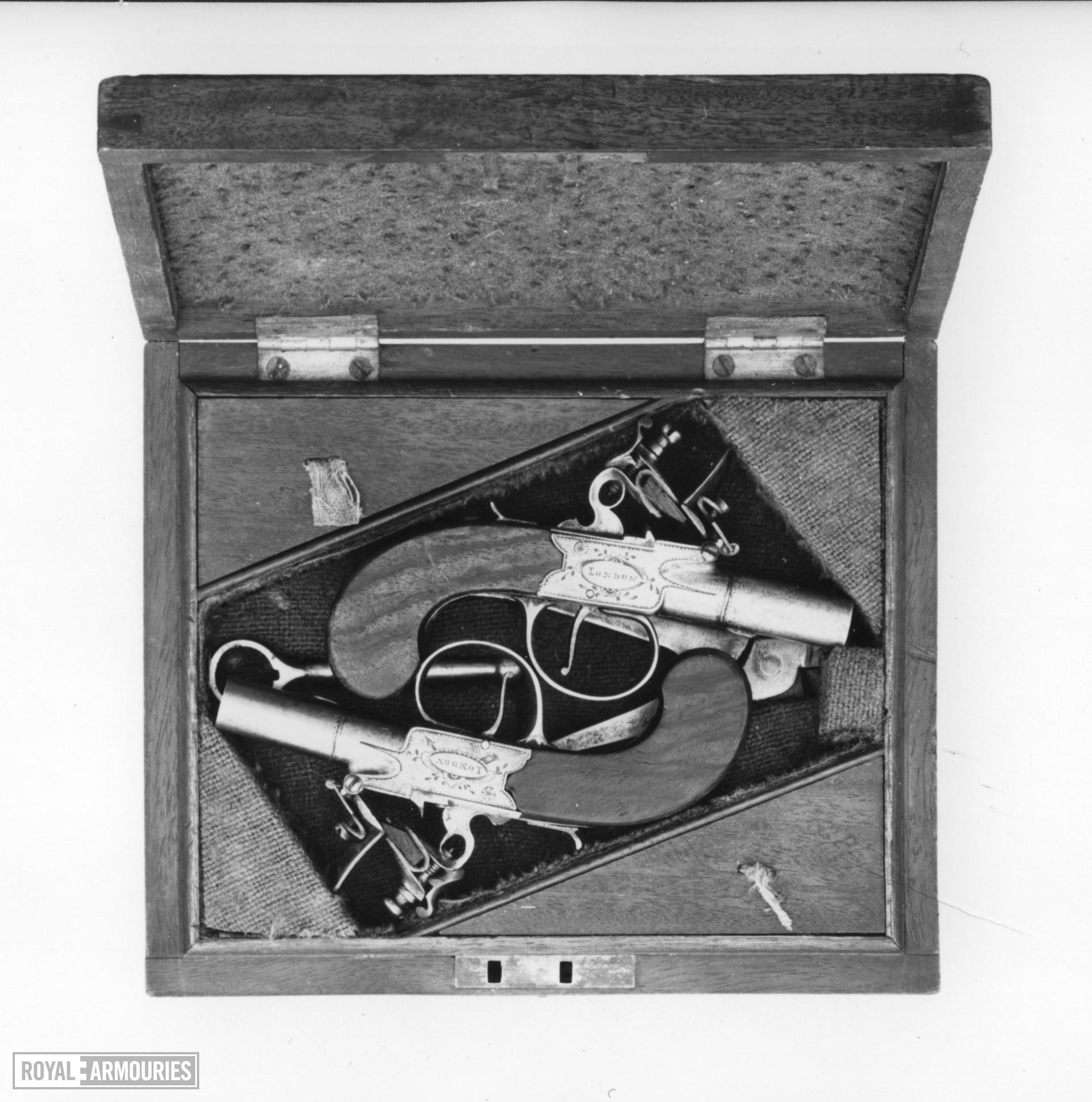 Flintlock pocket pistol By Perry Case; one of a pair; see XII.1739