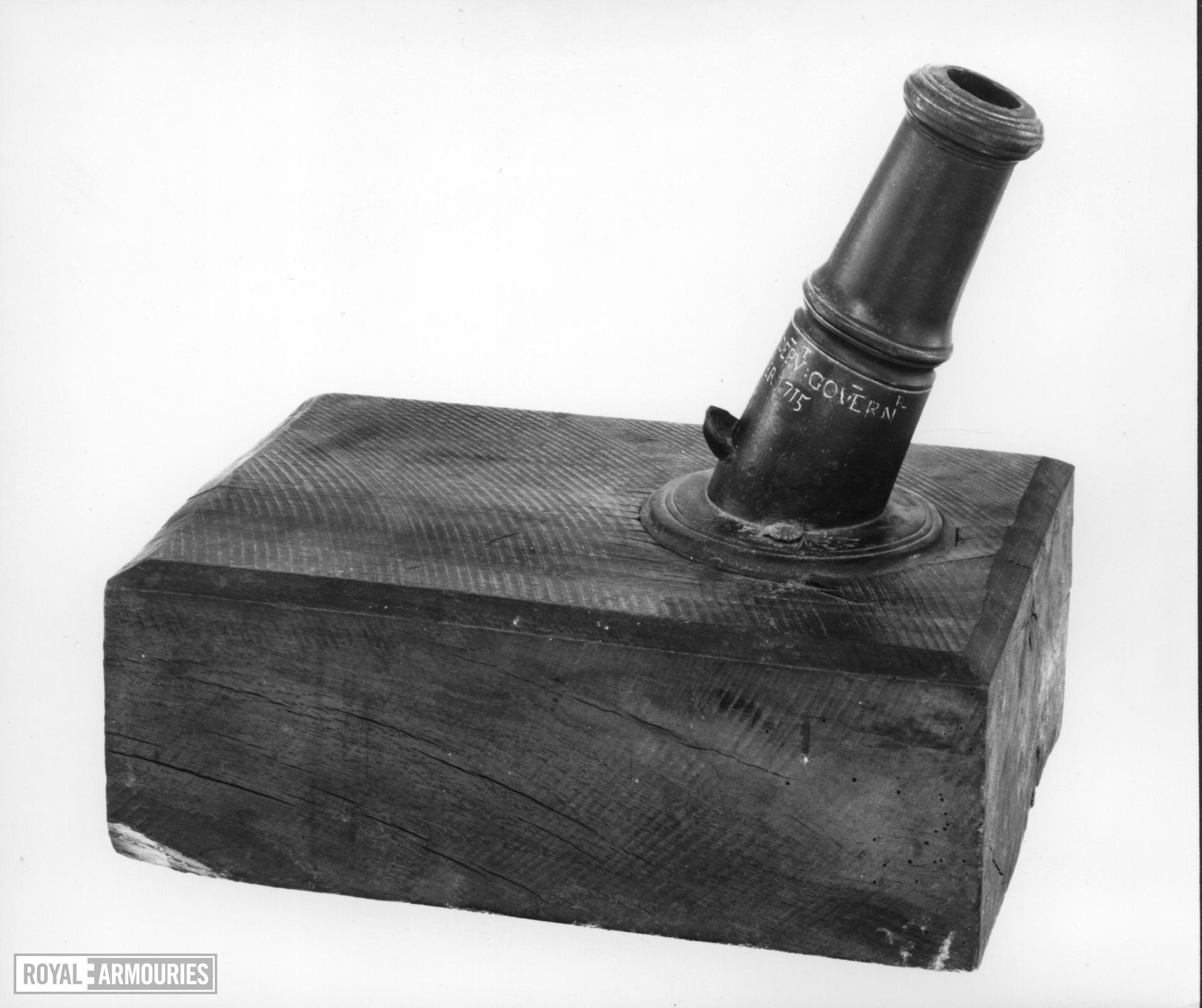 1.3 in mortar and bed Made of bronze Cast for R Doyle, deputy governor of the Tower of London 1715 Cf.XIX.288 virtually a pair