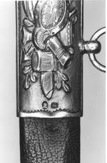 Thumbnail image of Sword and scabbard Heavy Cavalry Officer's dress sword and scabbard, presented to Lt Col. J.J. Smith of the 4th Regiment of Loyal London Volunteers, 1810; Pattern 1796 with solid silver grip and silver-gilt boatshell, hallmarks include the London assay marks for 1809/1810.