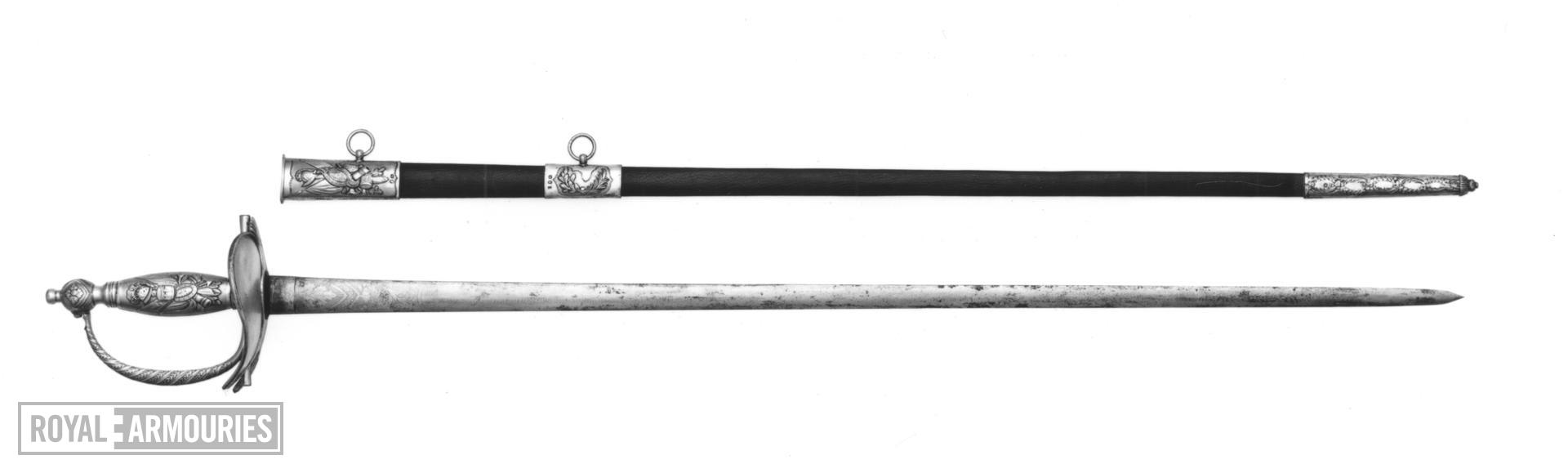Sword and scabbard Heavy Cavalry Officer's dress sword and scabbard, presented to Lt Col. J.J. Smith of the 4th Regiment of Loyal London Volunteers, 1810; Pattern 1796 with solid silver grip and silver-gilt boatshell, hallmarks include the London assay marks for 1809/1810.