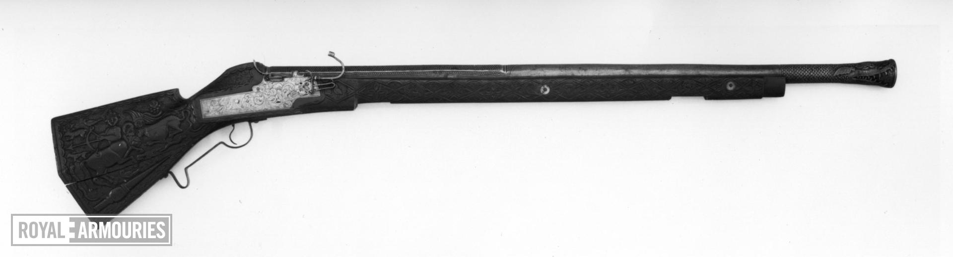 Matchlock muzzle-loading gun The barrel and stock are 19th century reproductions