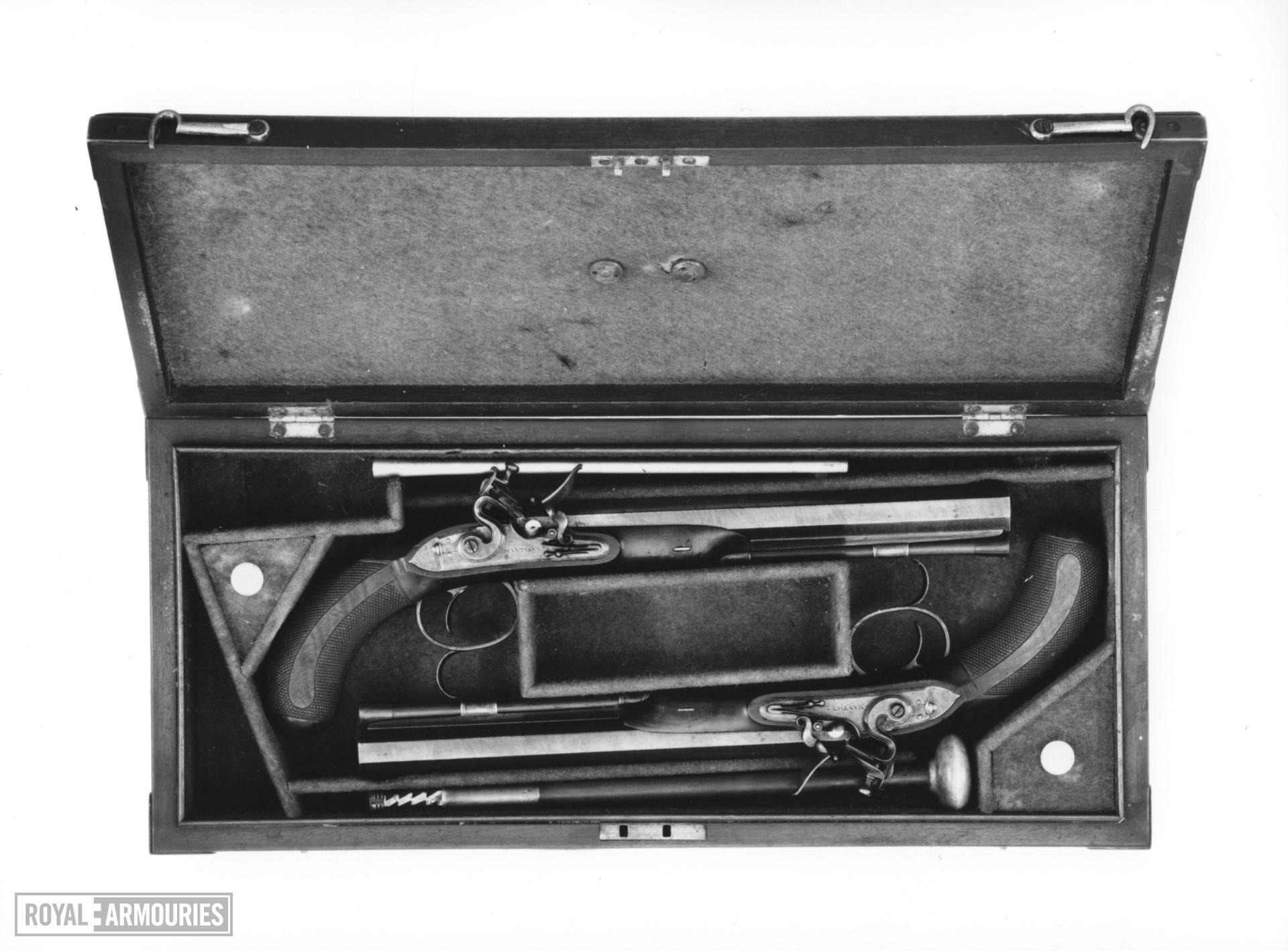 Flintlock duelling pistol By Manton, London Cased One of a pair; see XII.1732