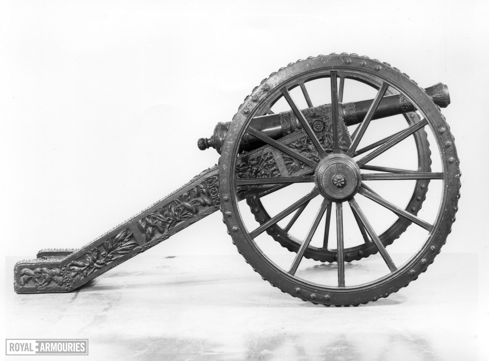 2.3 in gun and carriage Made of brass One of a pair of guns, see also XIX.36; carriage original