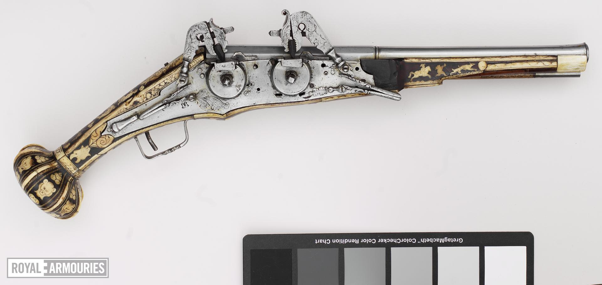 Wheellock superimposed pistol To fire two superimposed charges