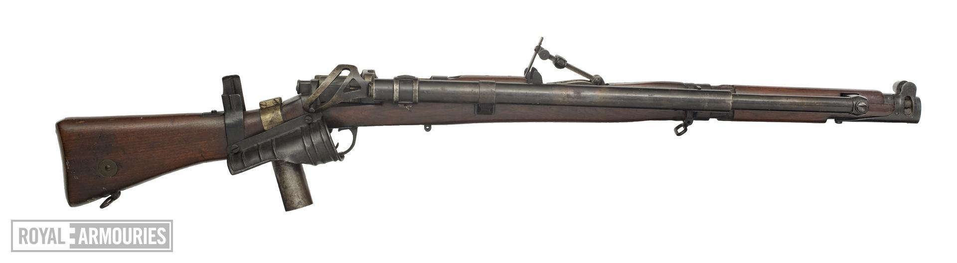 Centrefire self-loading magazine rifle - Lee-Enfield Mk. III Converted to self-loading using the Howell patent conversion.