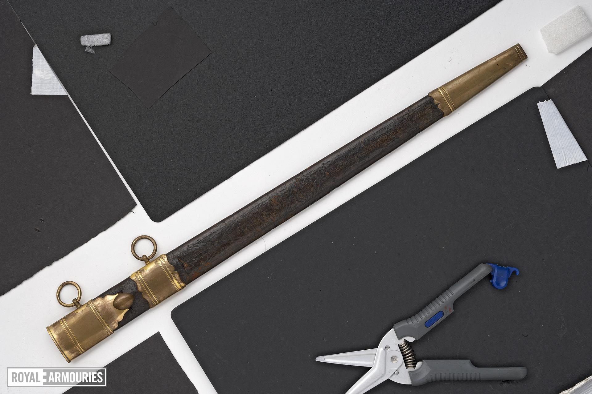 Dirk and sheath Long bladed military dirk and sheath by Thomas Gill, owned by Lt. Col. Jonathan Bullock of the Essex Militia