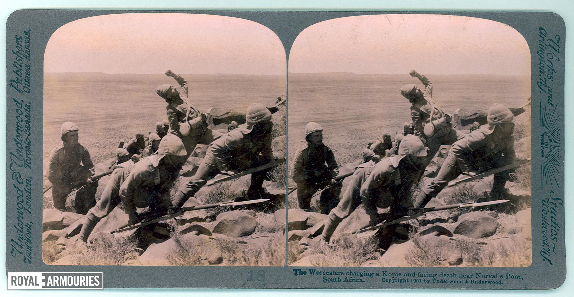 Stereoscopic photograph entitled '18, The Worcesters charging a Kopje and facing death near Norval's Pont, South Africa', Underwood & Underwood Publishers, 1901.  Armed with Mark I, Magazine Lee-Enfield rifles and Pattern 1888 bayonets, The Worcestershire Regiment charge a Kopje (hill) near Norvalspont, during the Colesberg Operations of the Second Boer War, about1900.