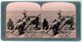 Thumbnail image of Stereoscopic photograph entitled '18, The Worcesters charging a Kopje and facing death near Norval's Pont, South Africa', Underwood & Underwood Publishers, 1901.  Armed with Mark I, Magazine Lee-Enfield rifles and Pattern 1888 bayonets, The Worcestershire Regiment charge a Kopje (hill) near Norvalspont, during the Colesberg Operations of the Second Boer War, about1900.