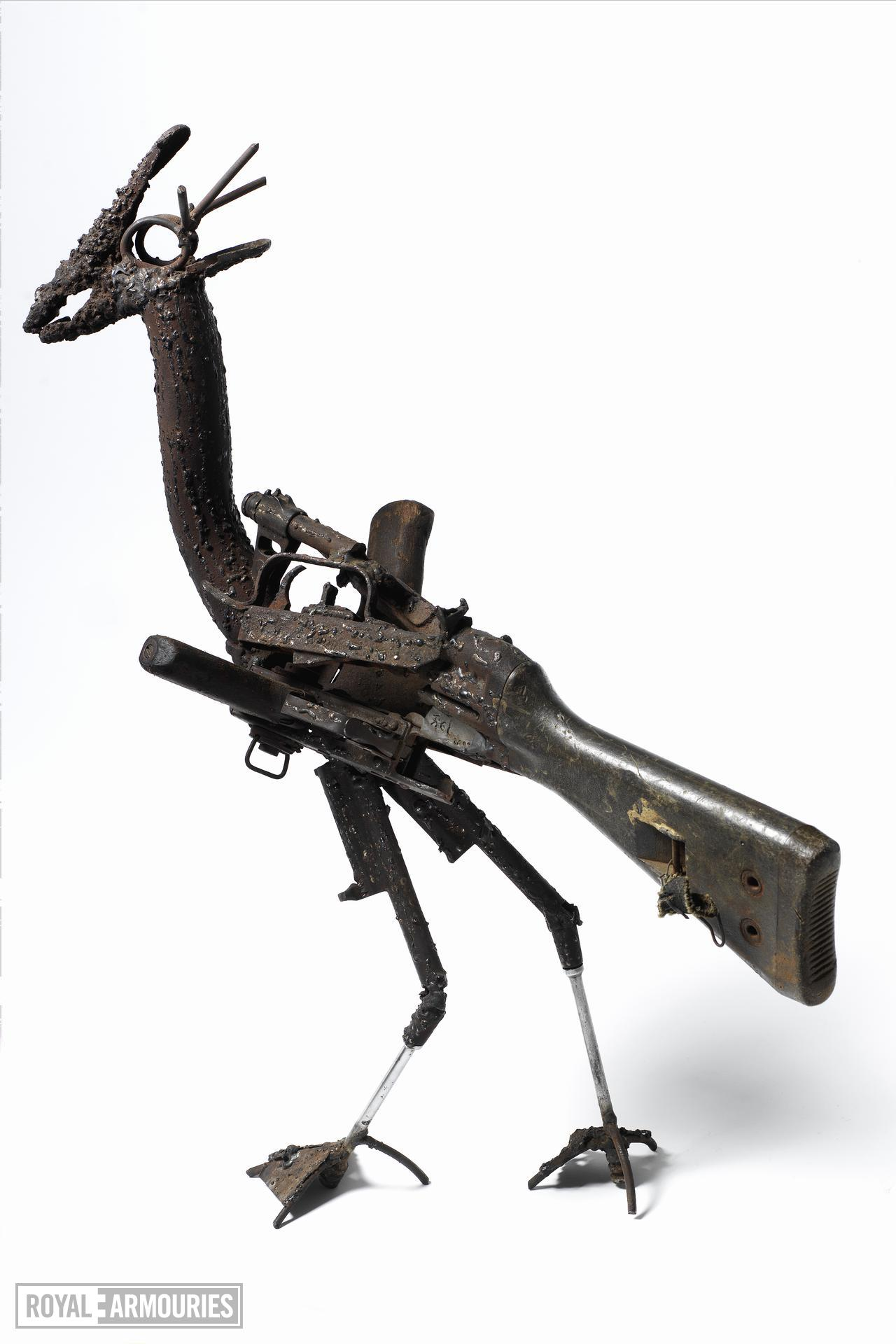 Sculpture - Bird that Wants to Survive An impression of a Black Winged Stilt bird made with firearm parts exchanged with Mozambican citizens in exchange for tools and bicycles supplied by western NGOs. By Fiel Dos Santos.